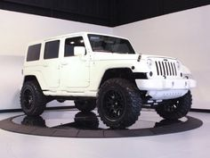 My dream vehicle jeep wrangler limited all white with black wheels and tinted windows!