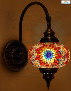 The globe is made from hand blown glass. We use hand-cut colored glass as well as glass beads to create the pattern ( we do not use painted glass