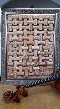 Masterpiece bulletin board made with corks and sheet music framed exquisitely.