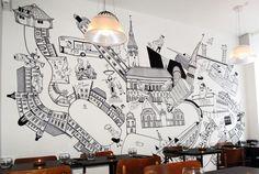fresque murale en noir et blanc caricaturisée - bâtiments et gens au pochoir