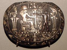 Part of a en:menat (a type of ritual necklace) depicting Haries Standing in front of the goddess Sehkmet, flanked by the gods Wadjet and Nekhbet (symbols of lower and upper Egypt respectively) Ca 870 BC Image taken at the Atles Museum,Berlin
