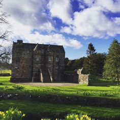 We are so lucky to have two castles on our estate! This is our 13th century castle today after the weather cleared up #rowallancastle #weddingvenues #13thcentury #history #magical #castles #scotland #daffodils #events #weddings #photography #weddingphotos