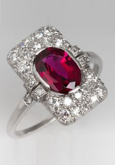 This stunning Art Deco ruby ring features a North to South design and a deep rich red ruby that is completely natural with no treatments. The ring is crafted of platinum and accented with eight old European cut diamonds and 22 round single cut diamonds. Red Jewelry, Dainty Jewelry, Art Deco Jewelry, High Jewelry, Turquoise Jewelry, Antique Jewelry, Jewelery, Vintage Jewelry, Jewellery Box