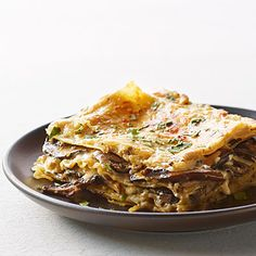 Mushroom and Fresh Herb Lasagna.  Mine is in the oven. I hope it turns out as good as this looks!
