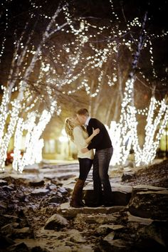 How romantic! And what a perfect and natural backdrop. The lights are a great touch for a winter engagement photo shoot!     St. Paul engagement photo by Graddy Photography