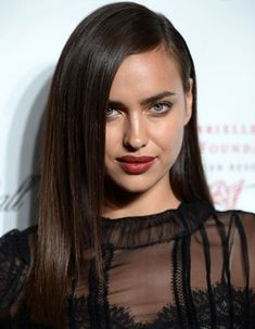 Irina Shayk's Long Straight Hairstyle with Deep Side Part