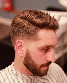The classic side part is also one of the most common men's hairstyles. That's because good haircuts for men work for a lot of guys and hair types. This modern verstion is somewhere in between