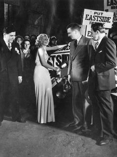 At midnight on April 7, 1933, Jean Harlow 'christens' the first truckload of beer to roll out of the Eastside Brewery, signaling the end of Prohibition, while R. Mentier, Walter Huston, and Charles J. Hick, brewery manager, look on. (Los Angeles Herald Examiner Collection, order# 00100925)