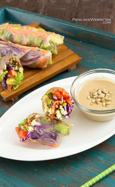 The crunch of fresh veggies paired with a creamy Asian inspired dipping sauce all together in one fantastic healthy spring roll. Gluten free, vegan, paleo, these are sure to fill you up without weighing you down. Perfect for lunch or dinner. Vegan, gluten free, paleo. | www.pancakewarriors.com