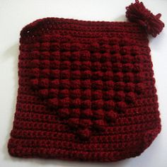 This square was designed for the knit-a-square charity.