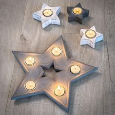 This beautiful grey star tea light holder holds 5 candles and gives a glorious glow in any room. Find out more here or simply buy online Decorative Accessories, Decorative Items, Magnum Ice Cream, Star Lanterns, Wooden Stars, T Lights, Star Decorations, Tea Light Candles, Hand Painted Ceramics
