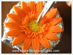 tutorial for making gum paste Gerbera daisies - scroll down a lot (not liking the larger outter leaves, but i might use part of this tutorial)