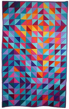 "I love the warm and cool color interplay here in this ""Fractured Sunlight"" quilt by Alice Knitter."