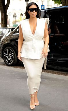 Kim Kardashian from The Big Picture: Today's Hot Pics  White hot! Kim stops by the Givenchy store in Paris looking très chic.