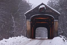 Corbin Covered Bridge  The Corbin Covered Bridge in Newport, NH, in a light snow storm. It's still wearing it's Christmas decoration.
