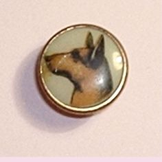 Antique gentleman's stud w/lithograph of a dog. Lion brand.