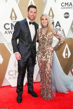 Carrie Underwood and Mike Fisher, Lauren Bushnell and Chris Lane and more celebrity couples hit the CMA Awards 2019 red carpet — photos Celebrity Couples, Celebrity Weddings, Celebrity News, Keith Urban Albums, Cma Awards 2019, Carrie Underwood Mike Fisher, Country Music Association, Entertainer Of The Year, Zac Brown Band