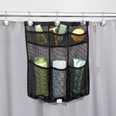 """NEW! Mesh Shower Caddy (Black) - Have all your shower essentials at easy reach. Durable waterproof mesh caddy hangs using existing shower curtain hooks, with pockets to fit all lotions and potions. Machine washable with rust-proof metal grommets. (17""""H x 16""""W) (Product Number ID04101) $14.98 CAD"""