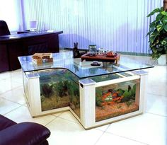 Coffee Table Aquarium Ideas http://goodshomedesign.com/aquarium-furniture-creative-coffee-table-aquarium/