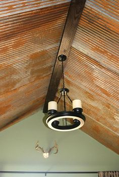 "love the wood up at top of ceiling also maybe we can ""distress"" new corrugated tin since we might not have enough of the old barn roof Barn tin ceiling. Acid stain new galvanized tin to work when you don't have enough salvage material. Corrugated Tin Ceiling, Metal Ceiling, Corrugated Metal, Galvanized Tin Ceiling, Corrugated Roofing, Galvanized Steel, Barn Tin, Barn Wood, Rustic Barn"