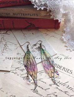 Hey, I found this really awesome Etsy listing at https://www.etsy.com/listing/216740676/pretty-new-faerie-wing-earrings