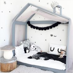 I LOVE this bed frame for Chase's new room! Would definitely stop him hurting himself if he falls out of bed due to all his rolling about!