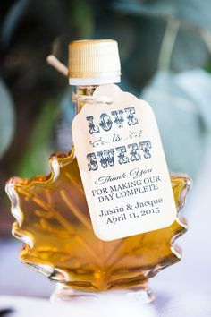 "Maple syrup favors in maple leaf bottles: ""LOVE is SWEET. Thank you for making our day complete."" 