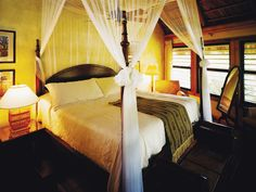 Guests are welcomed with tropical rum punch and their names on wooden plaques on their rooms at this
