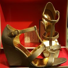 Coach wedges Worn a few time. Grey and gold wedges. Bottoms scuffed. Good condition. Coach Shoes Wedges