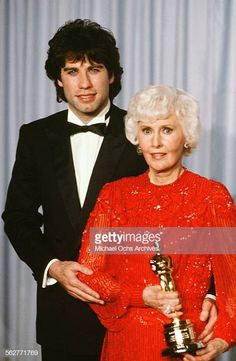 Actor John Travolta poses backstage with Barbara Stanwyck winner of. Actor John Travolta poses backstage with Barbara Stanwyck winner of the 'Honorary Academy Award' during the Academy Awards at Dorothy Chandler. John Travolta, Barbara Stanwyck, Pulp Fiction, Academy Award Winners, Academy Awards, Actor John, Lauren Bacall, Cary Grant, Joan Crawford