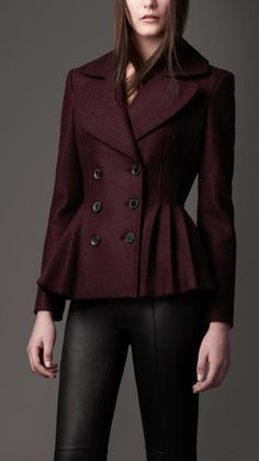 Elegant wool peplum jacket with oversize collar and leather martingale. Pleated peplum accentuates the feminine silhouette. Burberry