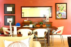 Orange is a great choice for your dining room because it refreshes your palate and adds warmth to your space. Orange walls or accents can make you feel more friendly and comfortable around other people, making conversations more fun and engaging. Click here to see more photos and view the complete home tour.
