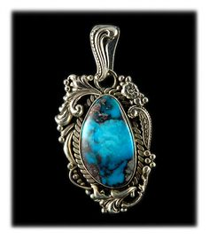 Fanciful Bisbee Turquoise Pendant by Durango, Colorado Jewelry artist John Hartman.  Isn't the color in this natural piece of American Turquoise wonderful?   This is a really different Turquoise Pendant.