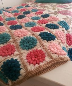 This is it! The perfect granny square for Fifi's bedspread. A raised flower without having to sew them on, beautiful and vibrant without a lot of colour changes. Perfect!!