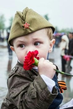 Little Russian boy wearing the Red Army soldiers cap in memory of their heroic feat. The photo was made on the 9th of May, the Victory Day in Russia. #kids