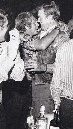 Steve Mc Queen and John Wayne... I think Steve may of had a couple Cocktails?