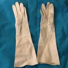 Vintage elbow length cream gloves Vintage elbow length cream gloves! Size says 6.5 but they seem to be much smaller!  Made in Italy-I believe they are genuine soft leather. Stitched together still.  Keep warm with these babies!  **Bundle to save! Price accommodates shipping and fees!** Accessories Gloves & Mittens