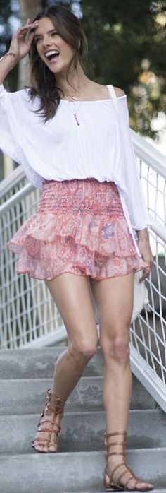 White long sleeve top, brown cage sandals, and pink print skirt