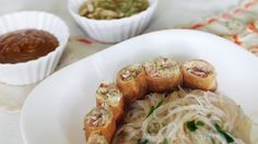 Ham and cabbage spring rolls with cellophane noodle salad
