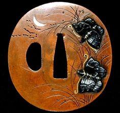 Tsuba (Edo Period) - Size:68mm x65mm x5mm 151g Nakago Size: 27mm x 9mm (5mm thickness) Material: Pure copper Signature: Unsigned Technique: Migakiji Katakiribori Takahorizogan Iroe Decoration: Akikusa ni cho zu (Japanese silver grass & butterfly)