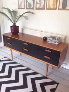 Beautifully restored mid century vintage sideboard in great condition. Painted black drawers. Looks