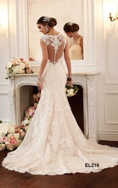 Illusion back, form fitting, amazing train detail,  vintage blush wedding dress so beautiful!!   Designer Bridal Gowns, Couture Wedding Dresses in Dallas TX