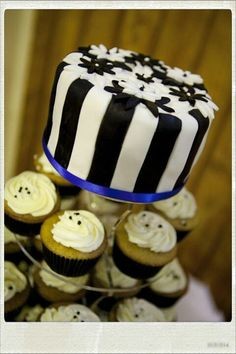 Black and White wedding cake with cupcakes Black And White Wedding Cake, Wedding Cakes With Cupcakes, Desserts, Food, Tailgate Desserts, Dessert, Postres, Deserts, Meals