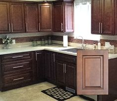 10X10 Kitchen: $1,459.38 Problem w/these cabinets is the layout is highly restricted and the price really jumps if layout is customized... won't work for us.
