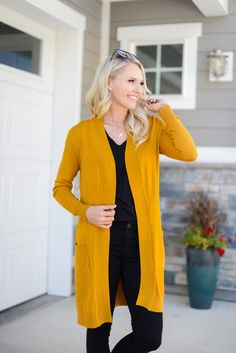 Fall is making an entrance with this gorgeous soft cardigan! This cardigan comes in 7 different colors and is a must have for your fall wardrobe! Sweater weather | Cardigan outfit | Black jeans | Fall colors | Fall fashion | Cardigan sweaters | Layering