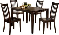 Hyland Ashley Reddish Brown Dining Room Table and Chairs Set of x x This compact dining set fills a small space with streamlined styling. Four ladderback chairs gather around the table for chatting and eating. Solid Wood Dining Set, 5 Piece Dining Set, Dining Room Sets, Dining Room Furniture, Dining Room Table, A Table, Condo Furniture, Dream Furniture, Furniture Shopping