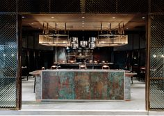 Joyce Wang Studio's latest restaurant in Hong Kong features burnt walls, a…