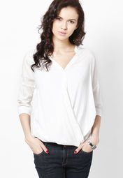 Look cool this summer wearing this off-white coloured wrap top from ONLY. Made from poly viscose, this regular-fit top can be comfortably worn all day long. This trendy top features 3/4th sleeves that will add a new twist to your casual look.
