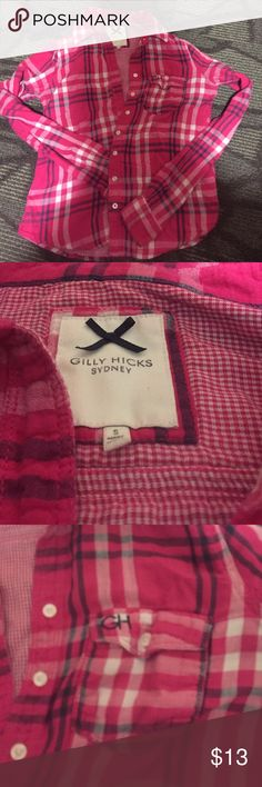 Gilly hicks flannel  Gilly hicks button- up flannel in excellent used condition. Size small but fits too tightly in my arms for comfort. Pink with plaid design. Collar and functional pocket Gilly Hicks Tops Button Down Shirts