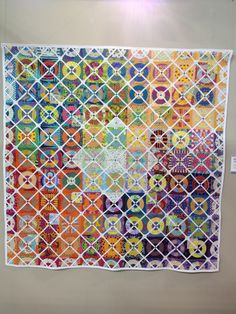 I'm not sure where this quilt is from, but it's stunning. I like how the thin white sashing creates such an interesting secondary pattern. I also like that the quilt-maker changed out quarters of some of the circle blocks for an additional hidden pattern (look closely).
